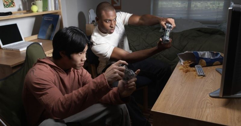 Teens playing playstation video game