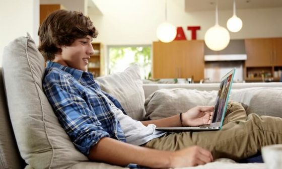 Young person watching video on his laptop