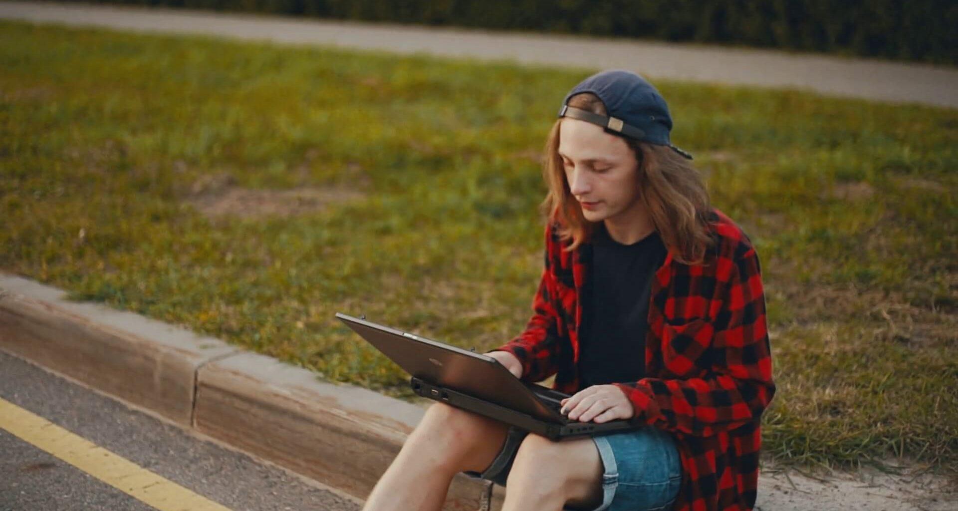 Young man looking at his laptop