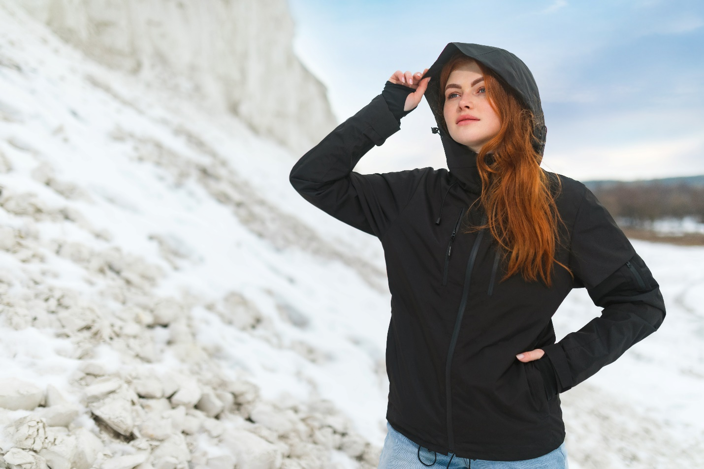 A person standing on a snowy mountain  Description automatically generated with low confidence