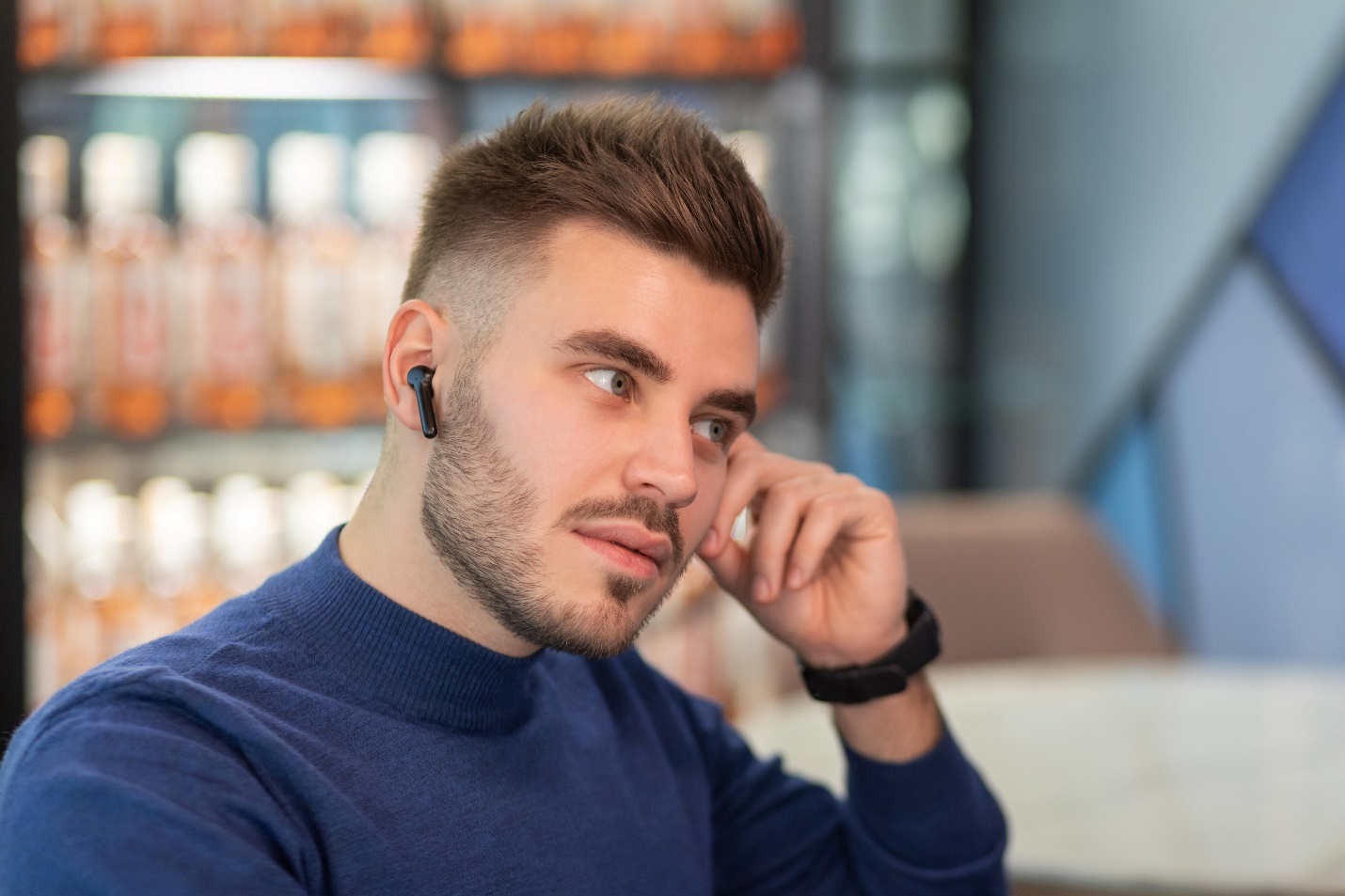A person with a beard talking on a cell phone Description automatically generated with low confidence