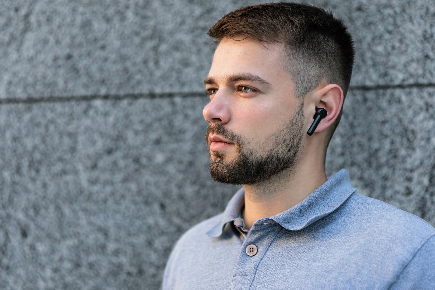 A person with a beard talking on a cell phone  Description automatically generated with medium confidence